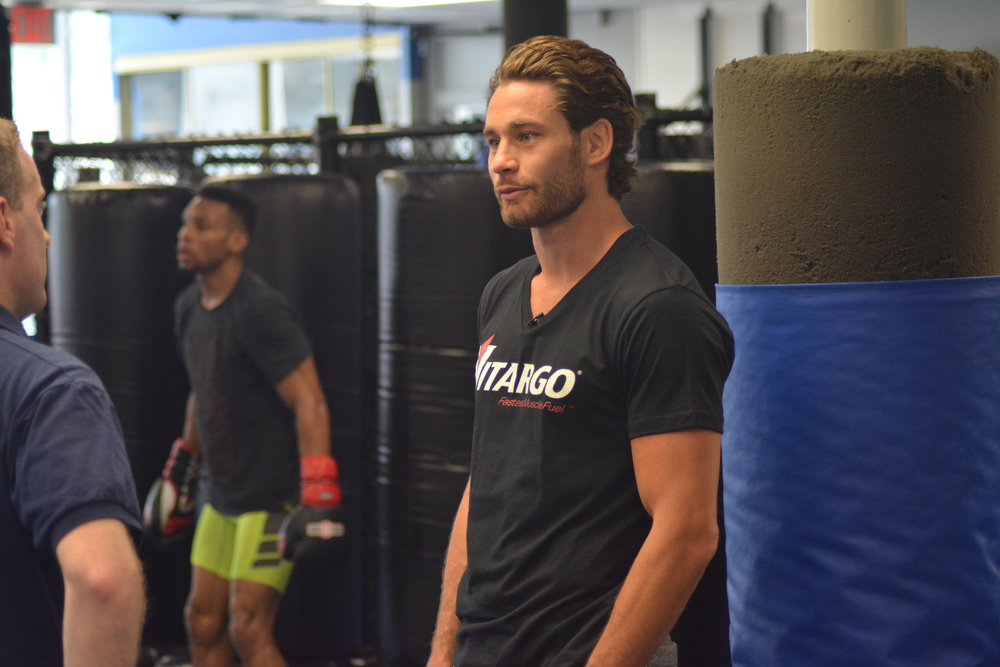 Before the sweat and hard work, Greenlawn's Chris Algieri makes time for interviews before a training session at Bellmore Kickboxing MMA.