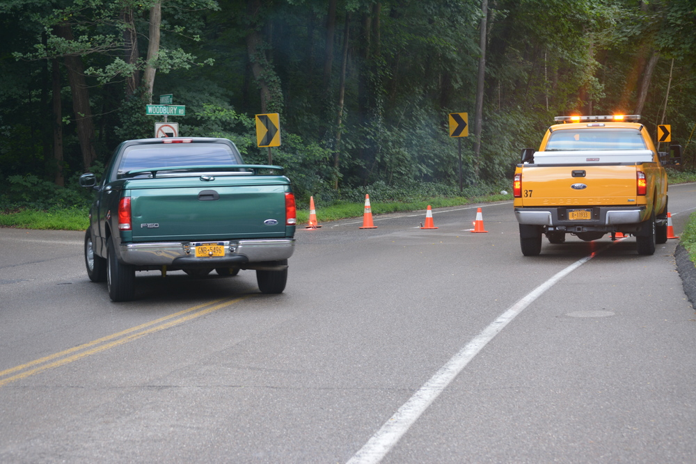 A two-car crash closes Woodbury Road in both directions from Hawxhurst Road to Donovan Drive on July 28, 2014. The results of a safety study on the stretch will be announced on June 15.