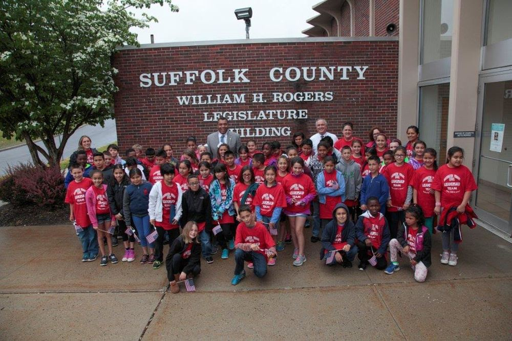 Sixty fourth-grade students from Washington Primary School traveled to the Suffolk County legislature Tuesday, where they urged lawmakers to install a traffic light near their school.