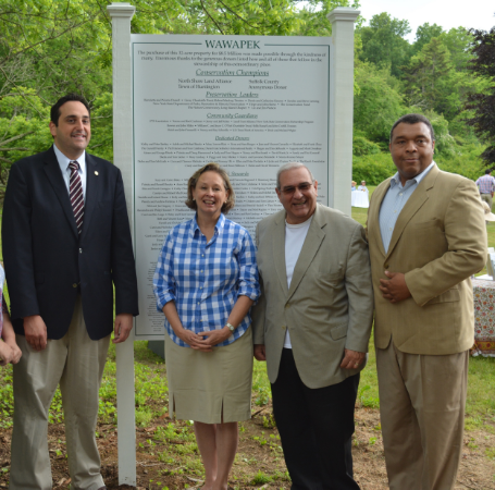 Assemblyman Chad Lupinacci, North Shore Land Alliance President and CEO Lisa Ott, Huntington Supervisor Frank Petrone and Suffolk County Legislator William Spencer at ceremonies dedicating the Wawapek Preserve in Cold Spring Harbor.