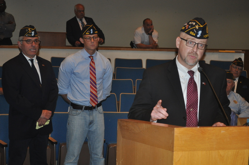 Northport American Legion Post 694 Commander John Cooney leads members in supporting legislation proposed by Councilwoman Susan Berland to crack down on fundraising fraud related to veterans.