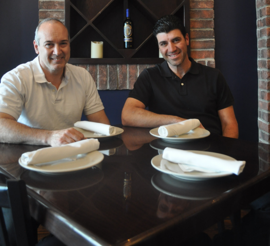 Eatalia owner Al Salese and manager Vinny Groe show off the elegant, yet homey dining room Friday.