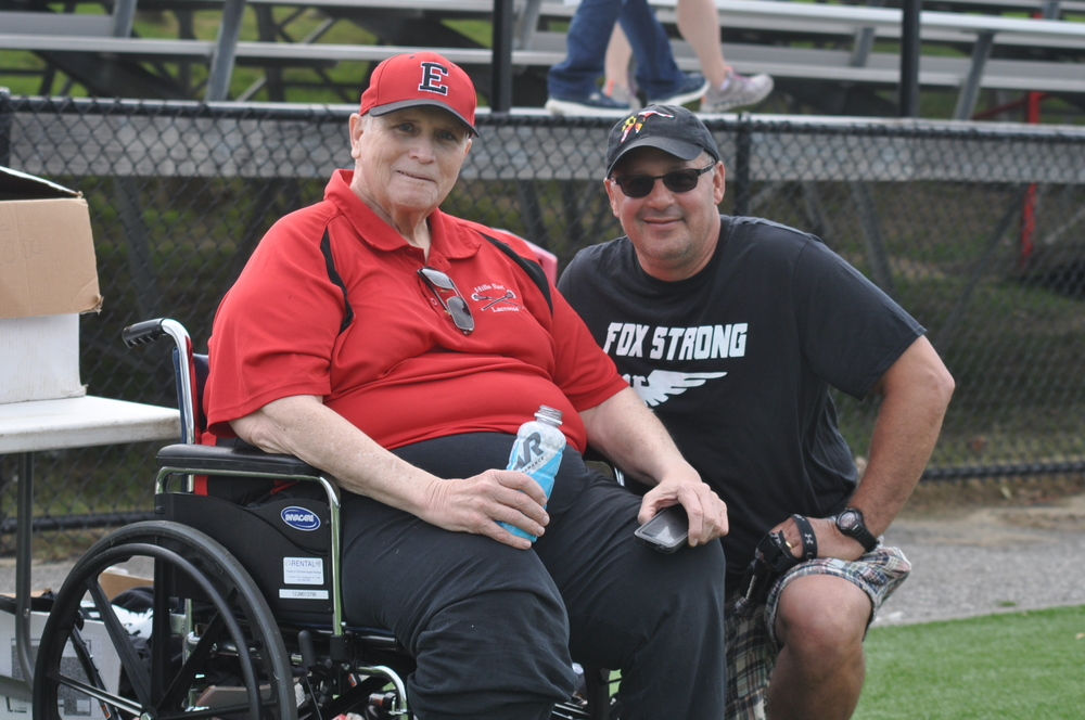 Pictured: Half Hollow Hills East boys lacrosse goalie coach George Fox and alumni game organizer Eric Geringswald.