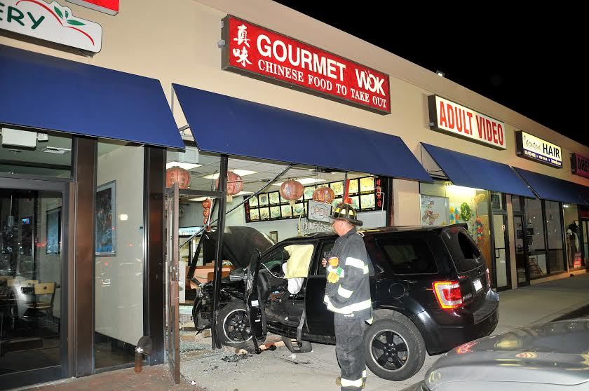 A man who police allege was drunk crashed his SUV into the Gourmet Wok on Walt Whitman Road in Melville at 10:20 p.m. Wednesday night. (Photo by Steve Silverman)
