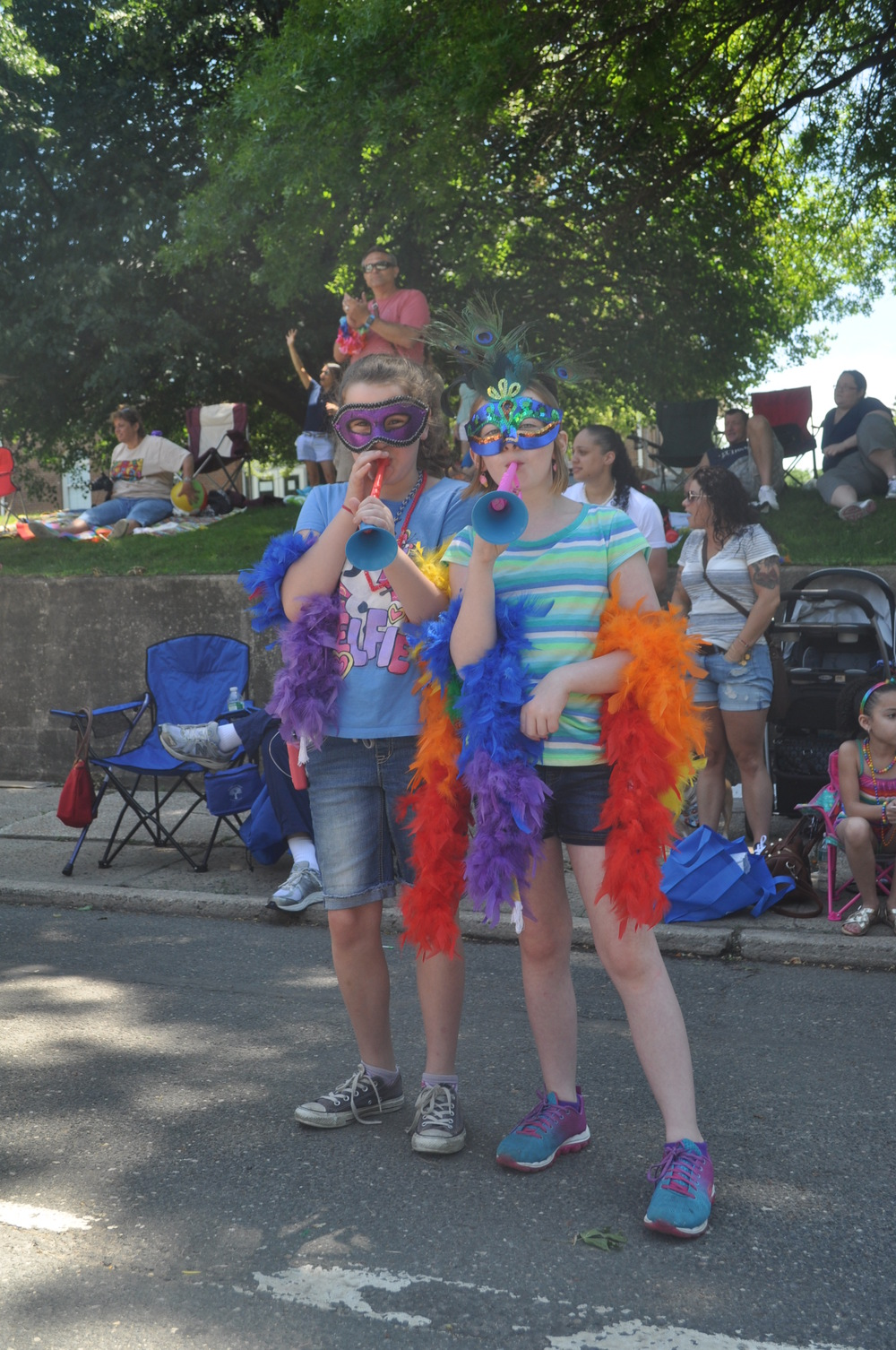 Young parade-goes make noise for pride in front of Town Hall.
