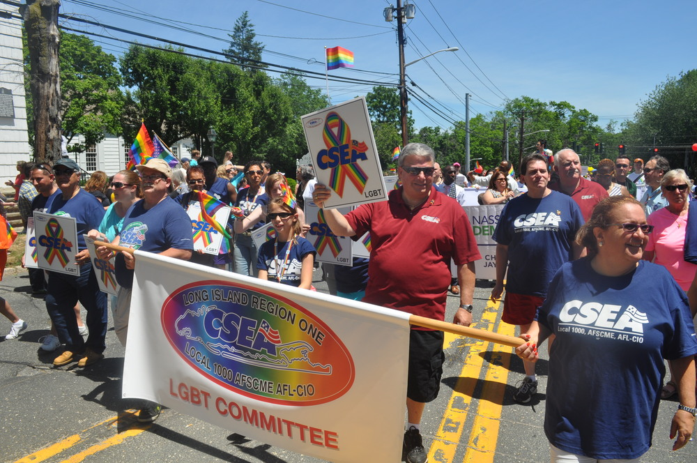 Members of the Town of Huntington's CSEA's LGBT committee march through Huntington. Organizers said this year was the first time a labor union had marched in the parade.