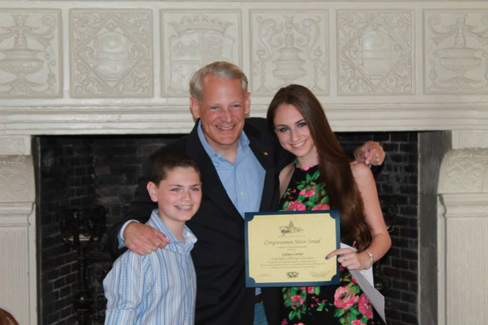 Congressman Steve Israel honors Hills East student Sydney Levine at LIU Post June 6.