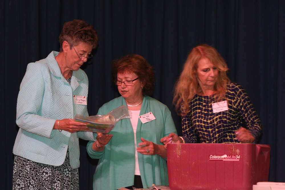 Emily Rodgers, former principal of Countrywood Primary Center in 1990, former Countrywood Assistant Principal Fran Hyde and Barbara Kenney dig into a 25-year-old time capsule, which was unearthed as a part of a ceremony commemorating the school's 50th anniversary.