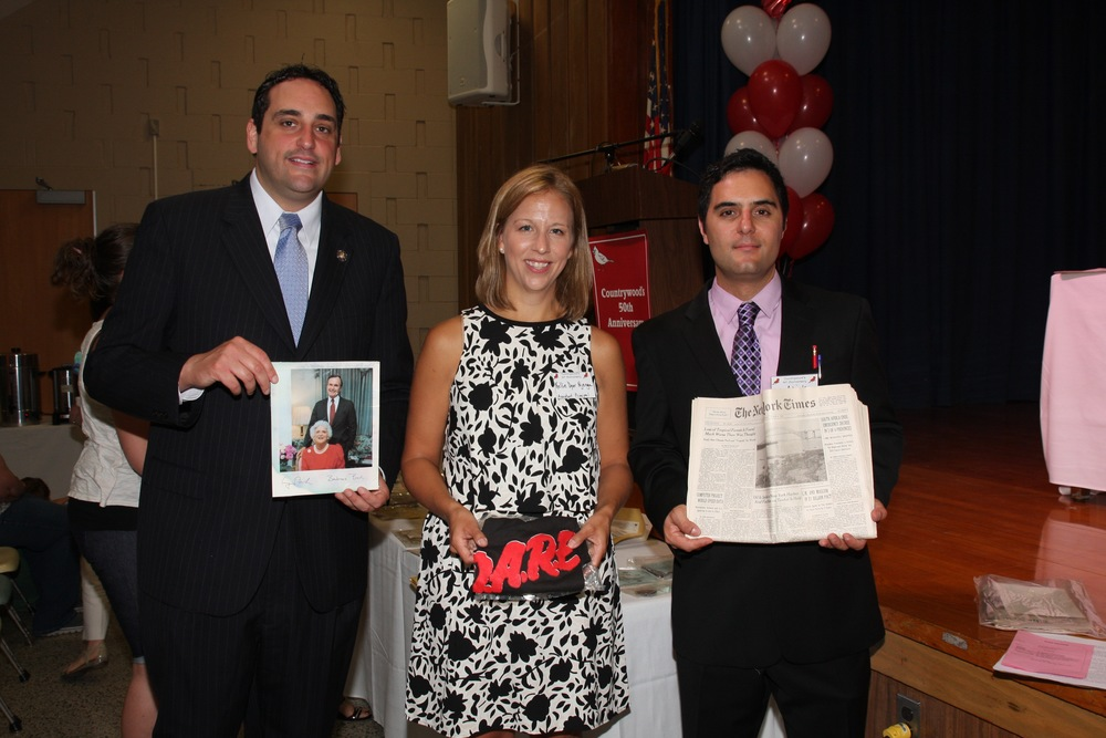 Assemblyman Chad Lupinacci, Countrywood Assistant Principal Kellie Njenga, and South Huntington school board vice president Nicholas Ciappetta, take a closer look at what was found in the time capsule.