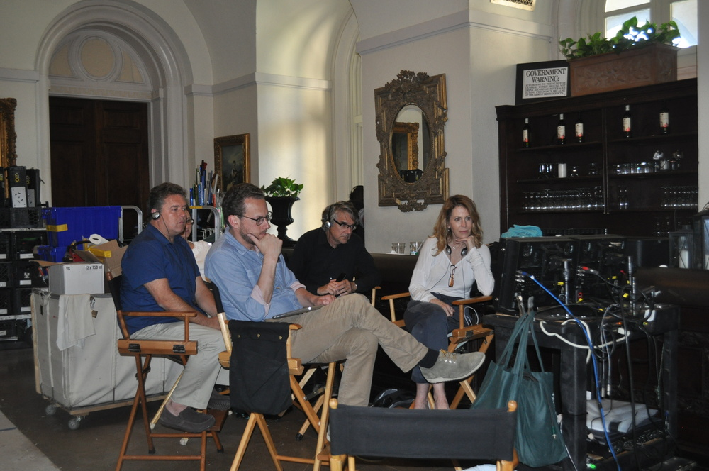 "Executive Producer Linda Berman, right, producer James Elkus, center, and line producer Moe Bardach, back left, look on as a scene from the upcoming miniseries ""Madoff""  is shot in the next room at Oheka Castle on Wednesday."