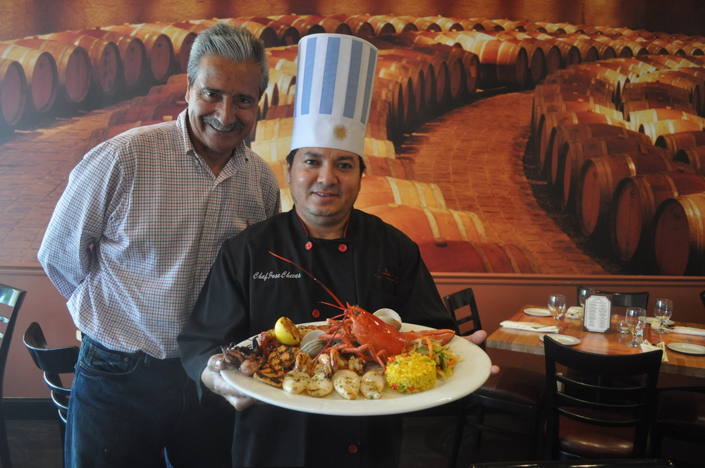 Hugo Garcia and chef Jose Cheves display Café Mendoza's Seafood Grill, a selection of perfectly prepared favorites that's bound to become a go-to plate.