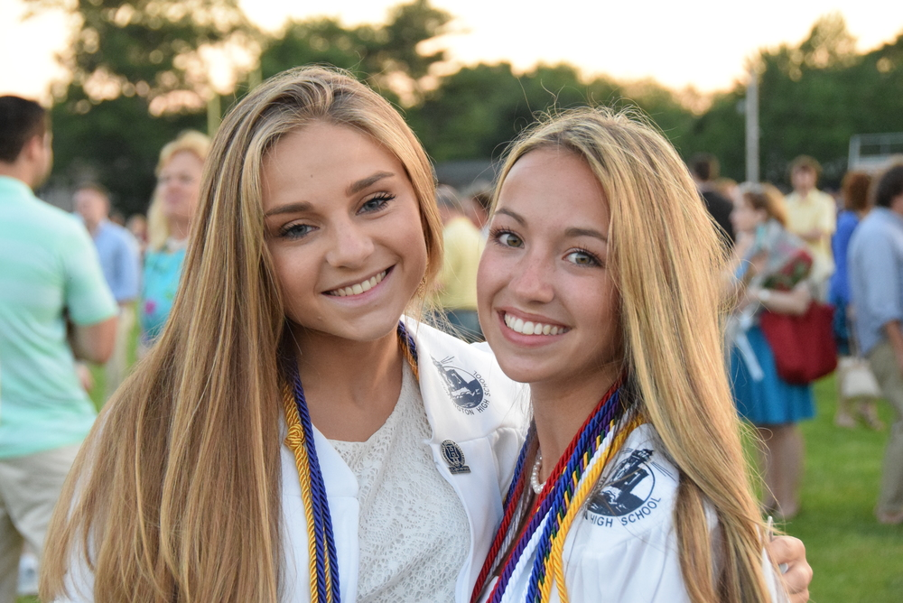 Seniors Darya DeSimone and Hillary Hardardt were all smiles after the Huntington High School ceremony. Photo by Jim Hoops