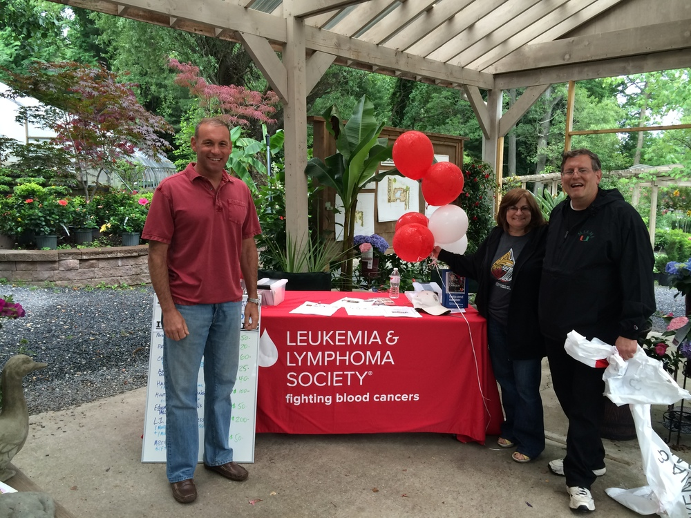 Suffolk County Legislator Steve Stern, left, joins Dix Hills residents Sheila and Howard Blechner on Saturday at the grand opening of the Perennial Gardener, which donated a portion of its sales that day to the Leukemia and Lymphoma Society.