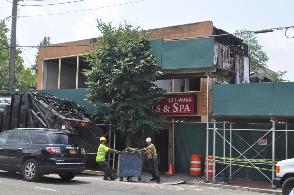 Work crews on Wednesday clean out 425 New York Ave., which owner Gary Field said he is in contract to sell to a developer for the purposes of building a three-story, mixed-use building.