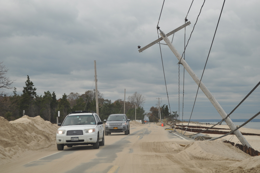 Asharoken Mayor Greg Letica wants the Army Corps of Engineers to back off on demands for public access in exchange for a beach-nourishment project. Pictured, the beach spills onto Asharoken Avenue after Superstorm Sandy.