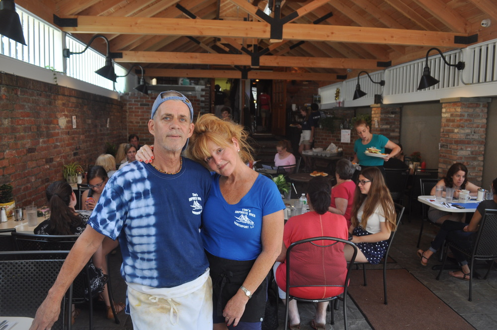 Tim Hess and Janet Eckel have turned Sunday morning at Tim's into the Breakfast Club in their newly renovated outdoor dining patio.