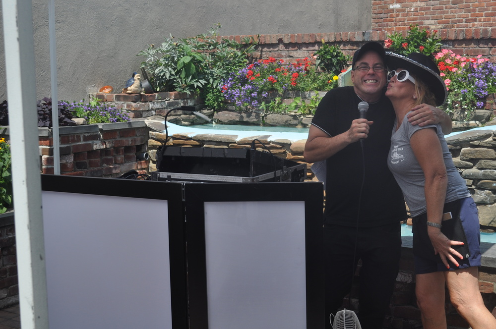 Janet steals a kiss from DJ Tommy Bruno, who does the tunes for the Breakfast Club.