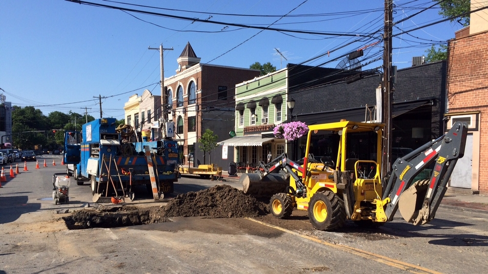A water main break left required Suffolk County Water Authority crews to dig up a part of Wall Street in Huntington village on Thursday. Photo by Carl Corry