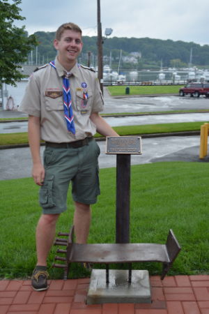 Huntington's Peter Magerle stands with the 9/11 memorial containing a piece of World Trade Center steal, which he assembled at the Halesite Fire Department as a part of his Eagle Scout project.