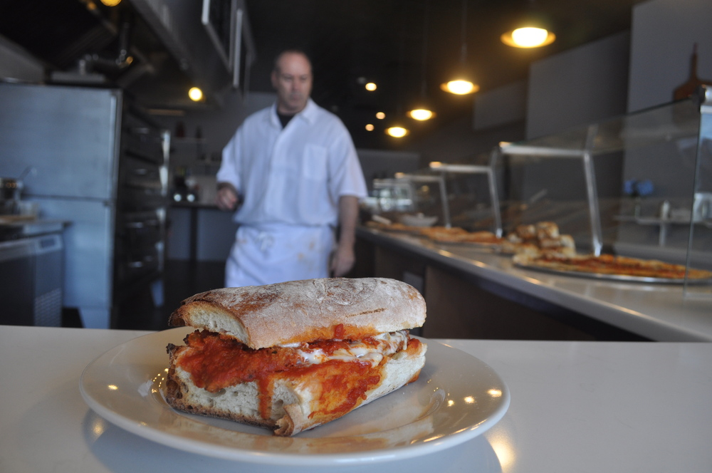 Take a seat at the pizza bar and enjoy a Chicken Parm hero on perfectly crisp, homemade focaccia toasted in the pizza oven.