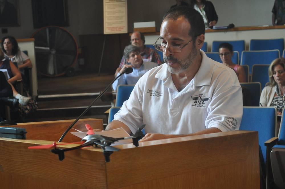 Dennis Andreas, president of Long Island Aero Modelers, speaks out against proposed legislation that would limit the recreational use of camera-equipped drones in Huntington at the July 14 town board meeting.