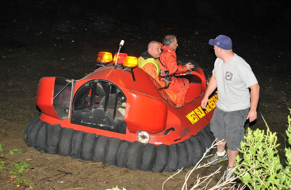 The West Islip Fire Department Hovercraft launches in the mud of Mill Pond in Centerport to rescue trapped couple in kayak. Photo by Steve Silverman