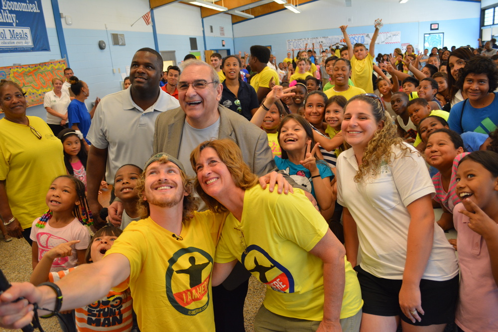 Huntington Station native Chris Strub, front left, visits Project PLAY and St. John's Camp Monday as part of his mission to volunteer with one youth organization in each of the 50 states in 100 days.