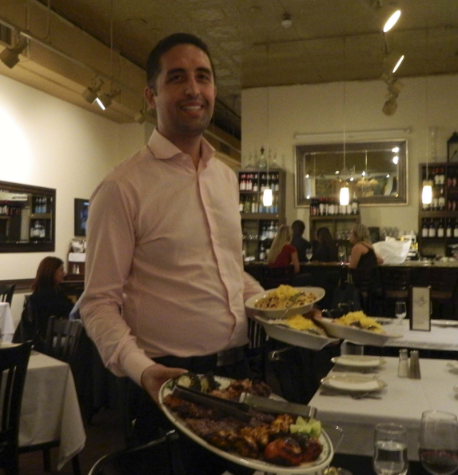 Ravagh owner Matt Tazari displays kebob platter (jujeh kebob, koobideh kebob and barg kebob) with basmati rice.