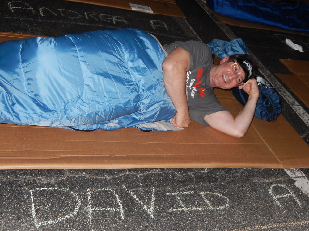 David Acker, CEO and president of Sleepy's, joins the Covenant House's Sleep Out fundraiser Aug. 6 by sleeping on cardboard on the pavement of the Sleepy's Hicksville headquarters parking lot.