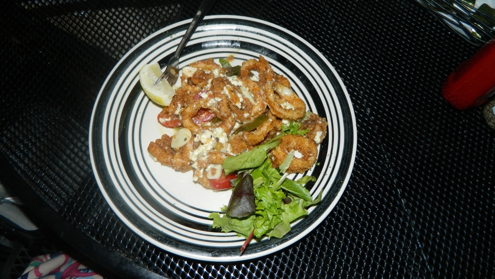 Calamari Calabrese with garlic, oil and cherry peppers with Gorgonzola cheese.