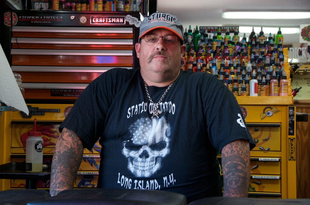 Local tattoo shop owner Chuck Brady, 44, sits at his workstation at Station 1 Tattoo on East Jericho Turnpike in Huntington Station.
