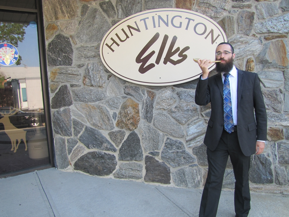 Rabbi Yaakov Yosef Raskin of the Chabad of Huntington Village blows the Shofar horn to prepare for the High Holiday services, which will be held in Huntington village at the Elk's Lodge from Sept. 13-15