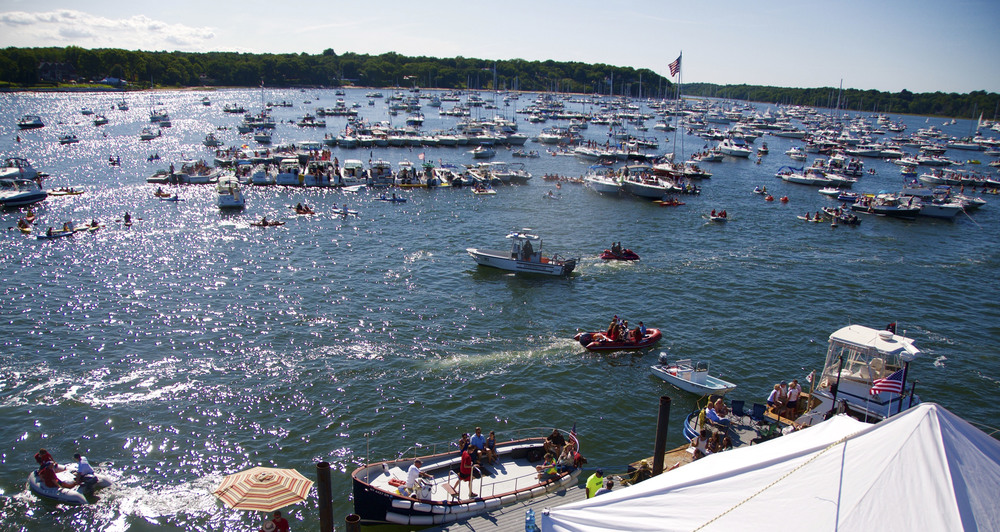 Boaters join in a day of music and relaxation in the tepid waters of Huntington Bay during the Huntington Lighthouse Music Festival on Sept. 5.