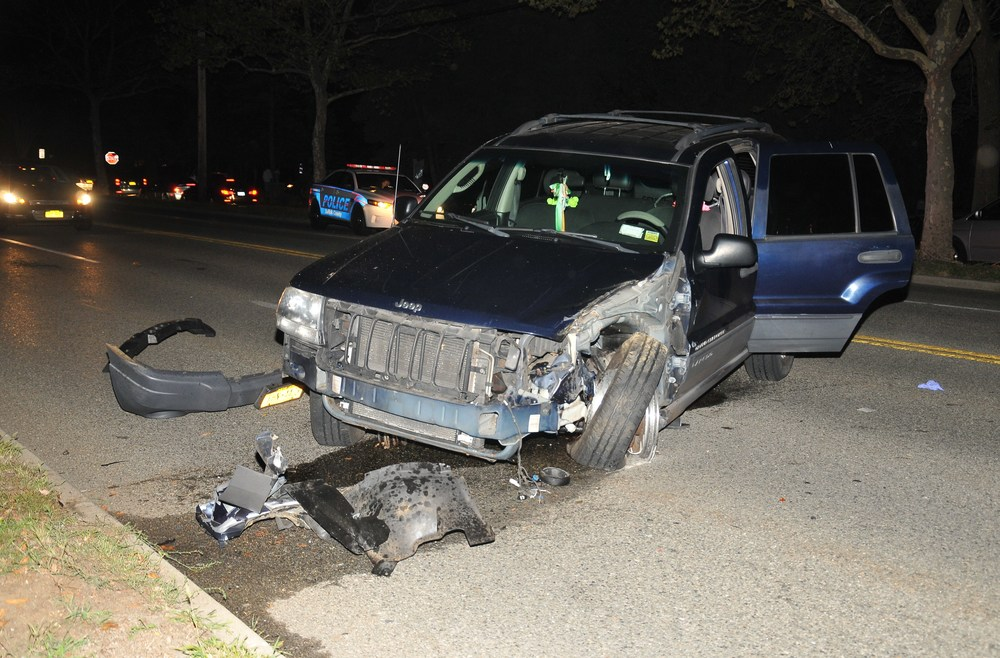 Police say a woman lost control of her 2004 Jeep and struck a utility pole on Larkfield Road in East Northport Tuesday (Photo by Steve Silverma)