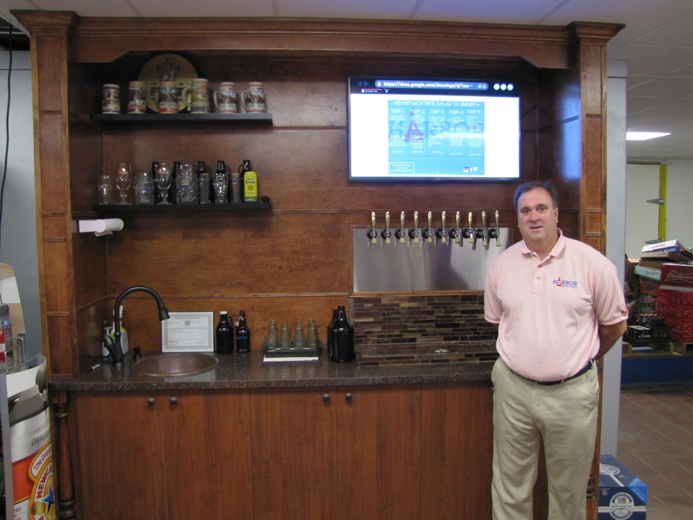 Matthew Griffith, 47, owner of Harbor Beverage Merchants in Huntington, is eager to expand the variety of craft beer through his growler services.