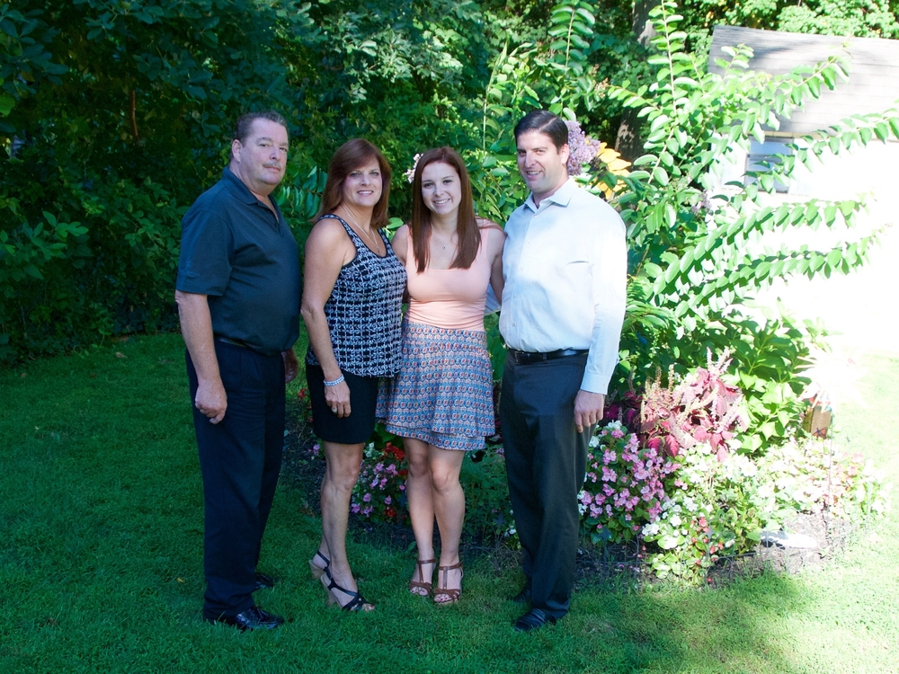 The Brower family in the backyard of their Dix Hills home in front of a garden planted in memory of John Brower Jr., who died of a drug overdose, in June 2014. From left to right: John Brower Sr., Jody Brower, Kristen Brower, Robert Brower.