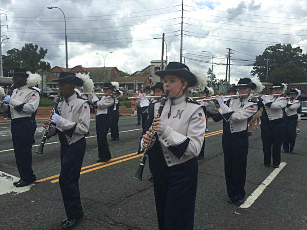 "Huntington High School Blue Devils Marching Band entertain the crowd lining Route 110 in Huntington Station for the annual Huntington Awareness Day ""Unity in the Community"" parade and fair."