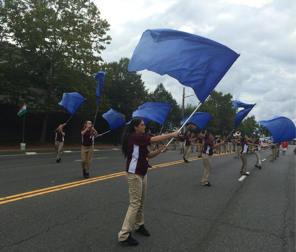 Walt Whitman High School Marching Band flag line shows its pride at the Huntington Awareness Day parade.