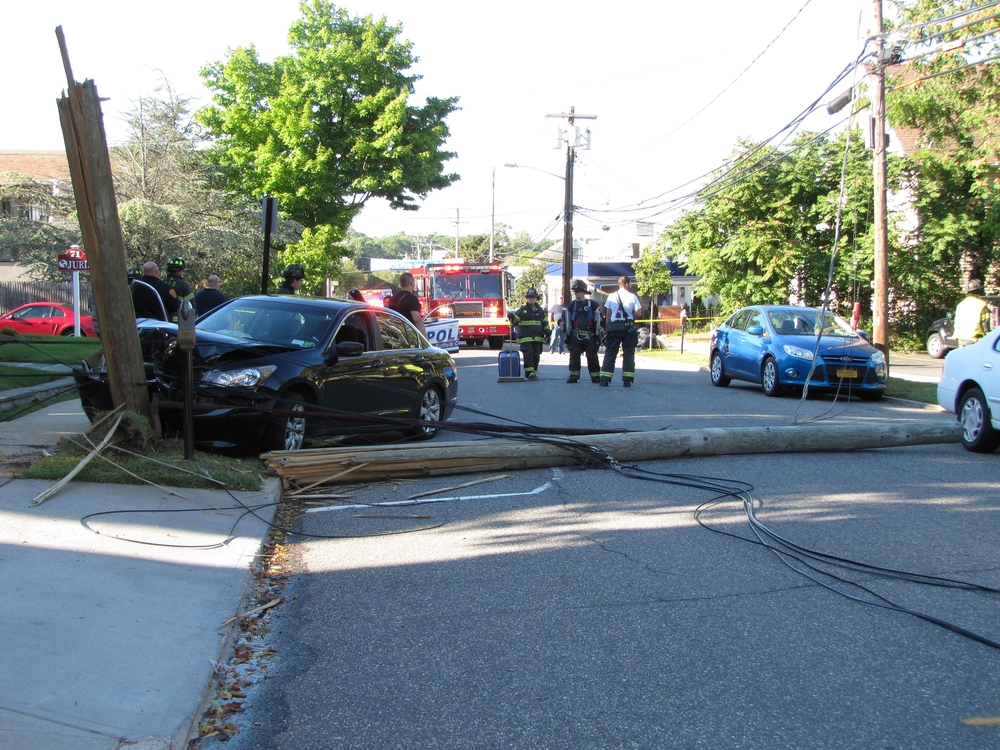 A black 2008 Honda Sedan crashed into a utility pole and split it in half on Monday afternoon, Sept. 14.