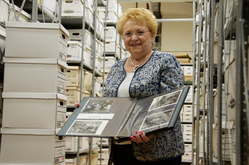 Jo-Ann Raia, who became the longest-serving town clerk for the Town of Huntington earlier this month, displays archival documents at Town Hall.