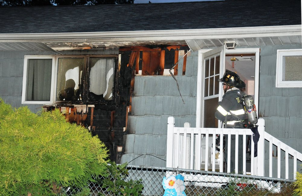 A Dix Hills home was damaged when a barbecue fire spread to the house's exterior. Photo by Steve Silverman