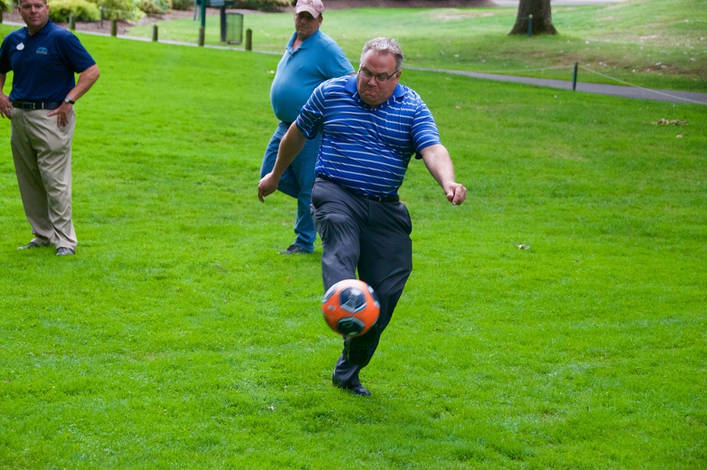 Don McKay, director of parks and recreation for the Town of Huntington, kicks a soccer ball at the Dix Hills Park Golf Course Sept. 28 to demonstrate the game of FootGolf.
