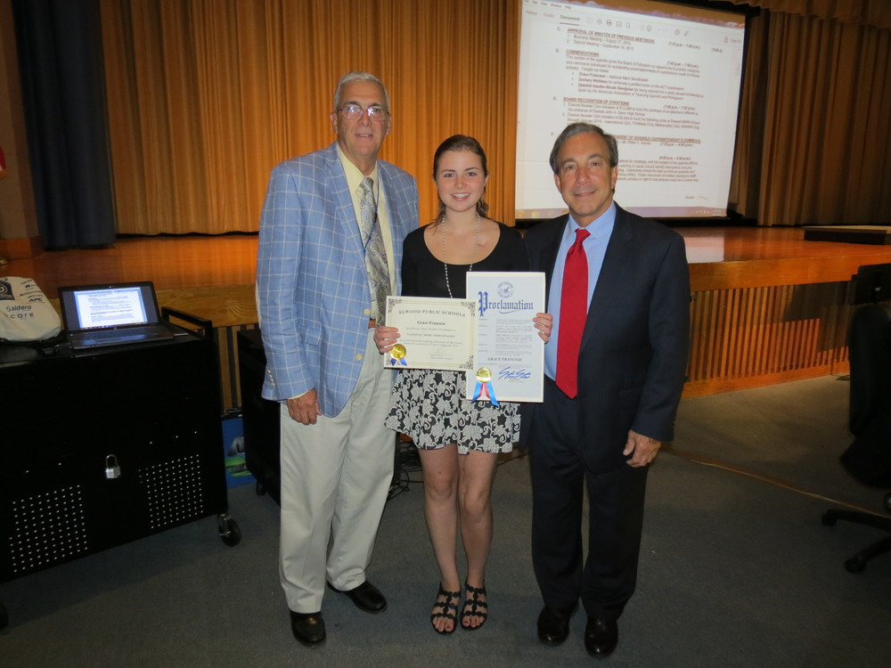 Elwood-John   H. Glenn High School   senior Grace Franzese with high school principal Jim Ruck, and Elwood Superintendent Peter Scordo, after receiving her National Merit Semifinalist certificate. (Photo/Toni-Joy Incandela)