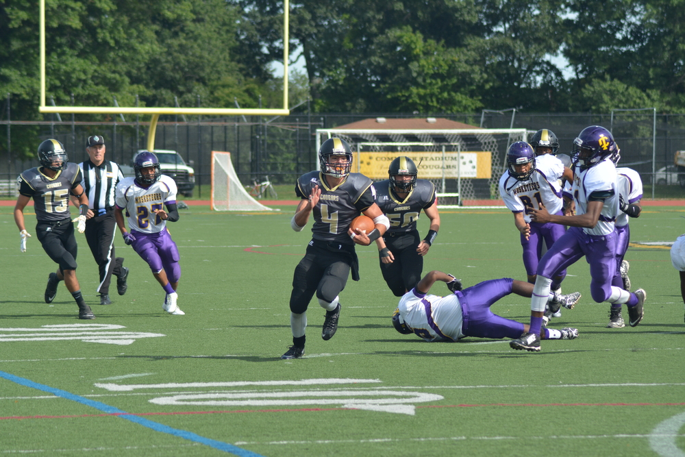 The Cougars' senior offensive weapon, Augie Contressa, returns a punt for 38 yards to Central Islip's 1-yard line in the first quarter of Saturday's homecoming game.