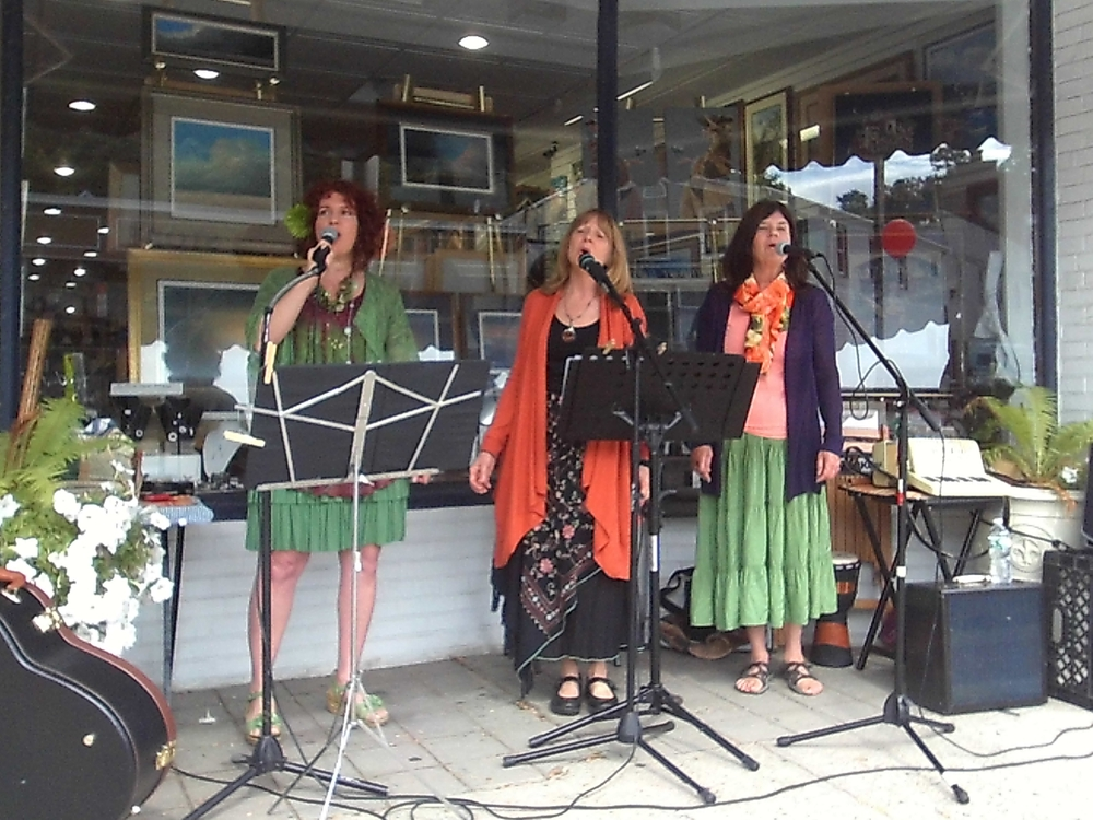 The Wild Ginger trio Caren Jacobs, Candice Baranello and Maureen Keelty perform by Wilkes Gallery during Sunday's ArtWalk. Long Islander News photo/Linda Delmonico Prussen