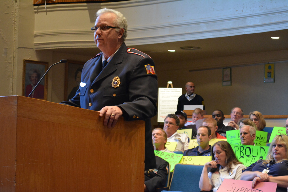 Tom Lemp, chief of Huntington Community First Aid Squad, was one of 16 speakers Tuesday night that pleaded for the town board to reconsider proposed cuts to the squad's funding.