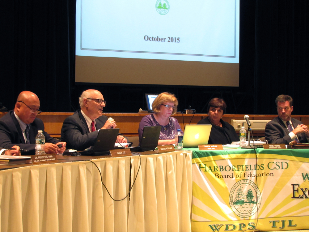 Harborfields Board of Education Members Hansen Lee and Nicholas P. Giuliano, District Clerk Sharon Whelan, Superintendent Diana Todaro and President Thomas McDonagh announce highlights of capital improvement bond at the board of education meeting on Wednesday, Oct. 7.