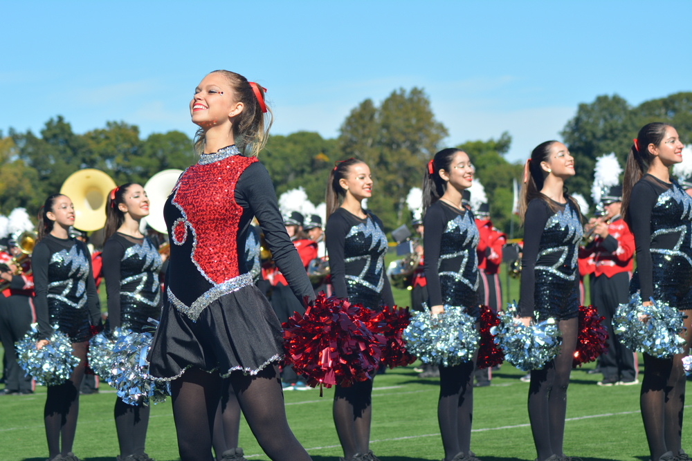 The Thunderbirds varsity cheerleaders pump up the crowd moments before kickoff on Saturday.