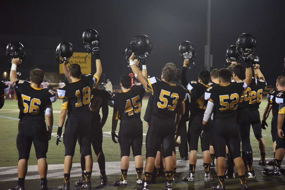The Friars raise their helmets Friday night. They defeated visiting Chaminade 45-17 on homecoming day.