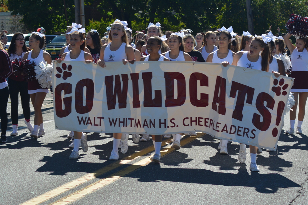 Festivities begin bright and early Saturday morning as a homecoming parade, including the Whitman's cheerleaders, ends at the high school's doorstep.
